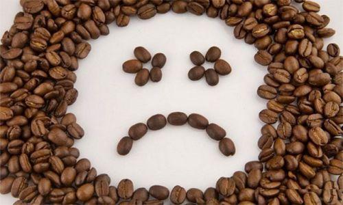 Унылая рожица из кофейных зерен