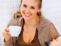 Женщина с чашечкой кофе